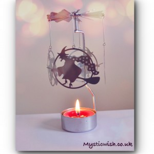 Spinning tealight holder witch broomstick