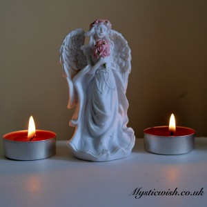 Pink and white flower angel