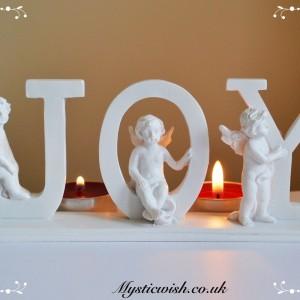 Plaque with cherubs joy