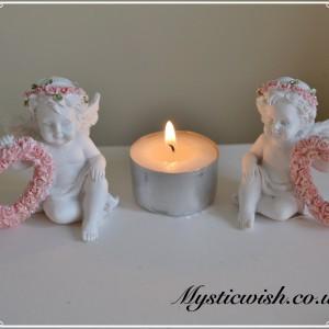 pink cherub holding hearts