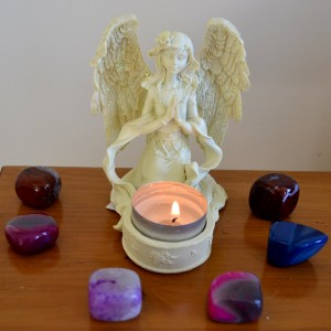 cream praying angel candle holder