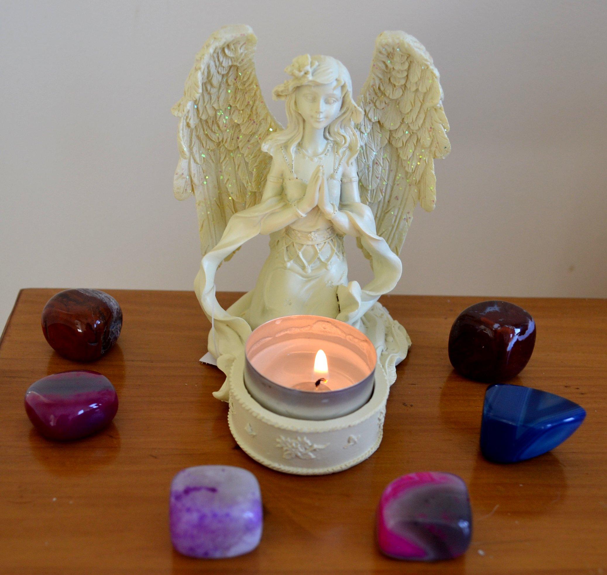 Cream praying angel tealight candle holder