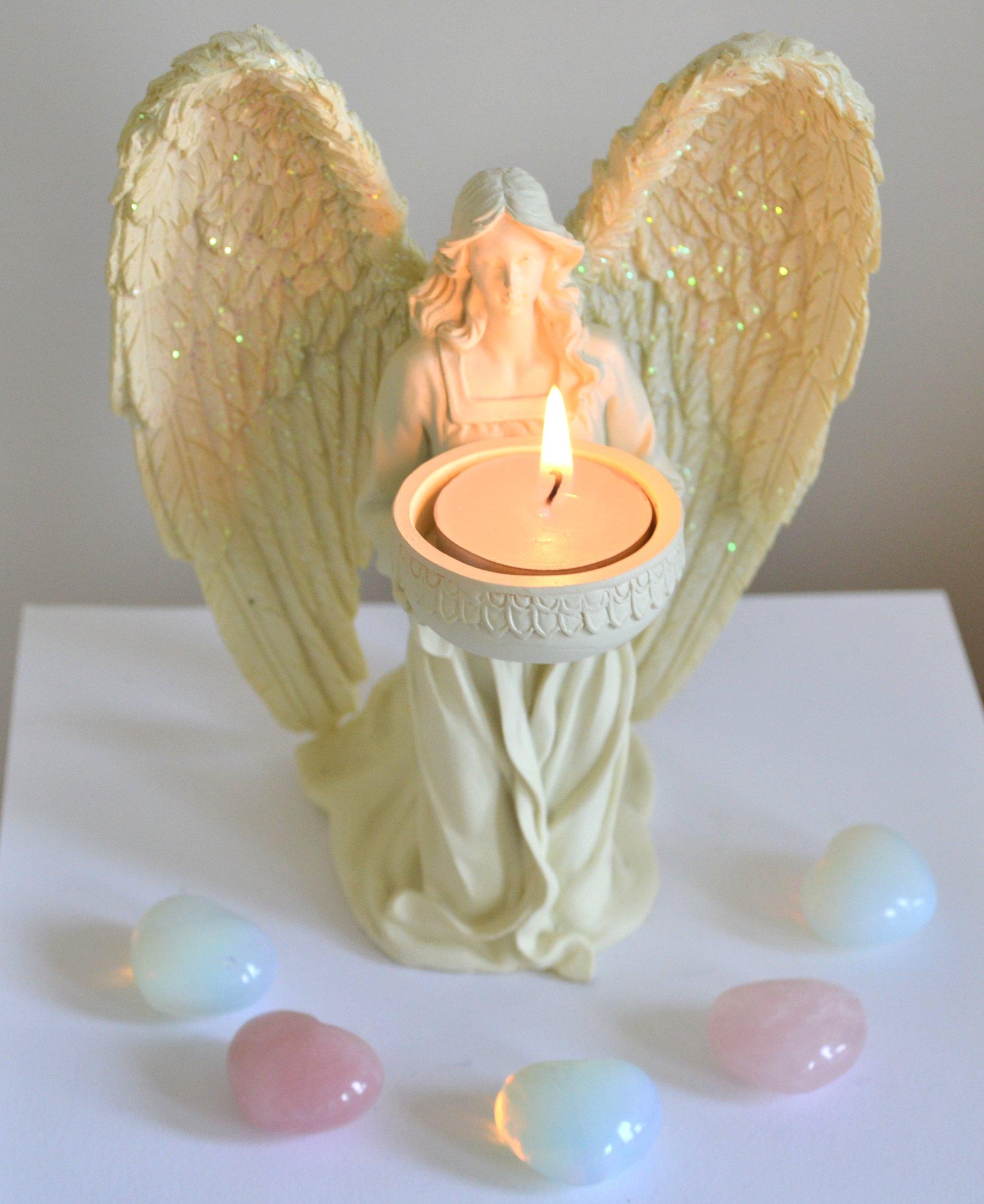 Kneeling cream angel tealight candle holder
